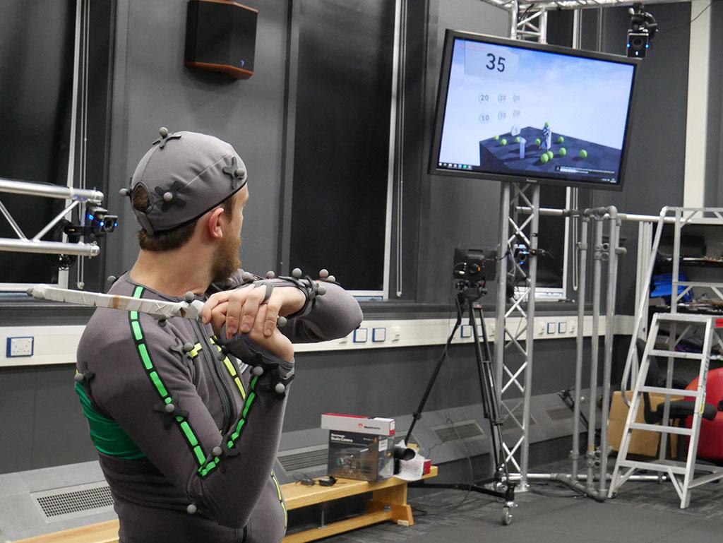 Swinging our actual/virtual reality bat at balls.